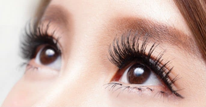 Close up of Asian eyes with dark, long Latisse lashes