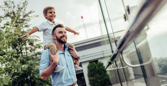 Father with son on his shoulders remains healthy and active